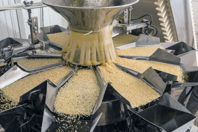 A photograph of machinery in an automated food factory that produces pasta