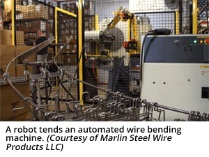 A robot tends an automated wire bending machine. (Courtesy of Marlin Steel Wire Products LLC)
